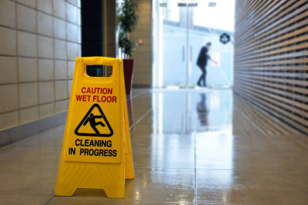 Slippery floor surface warning sign and symbol on a wet floor stock photo