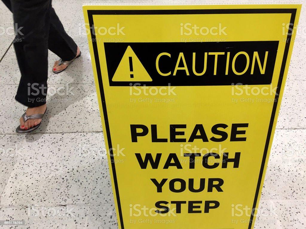 Slippery floor surface warning sign stock photo