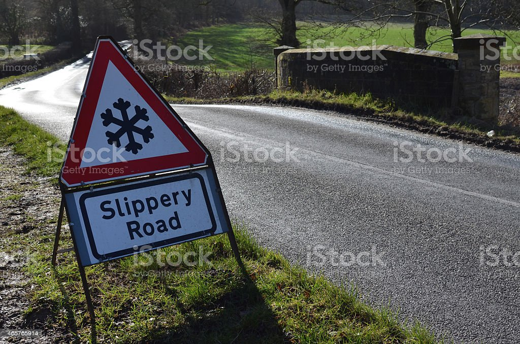Slippery road traffic sign. stock photo