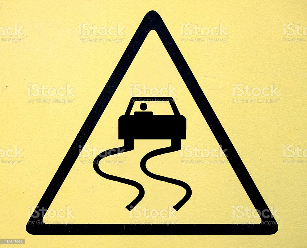 Slippery when wet road sign stock photo