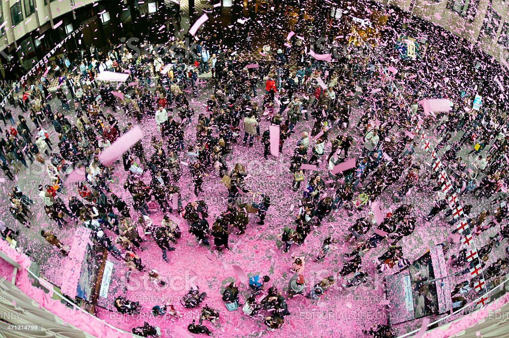 Slips of paper thrown onto a square full of people stock photo
