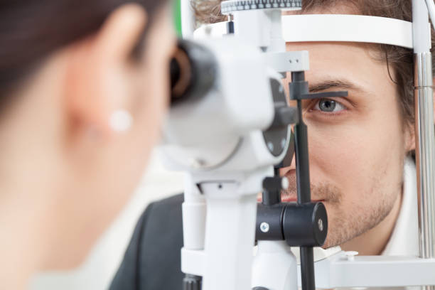 slit lamp eye control with the ophthalmologist - optical instrument stock pictures, royalty-free photos & images