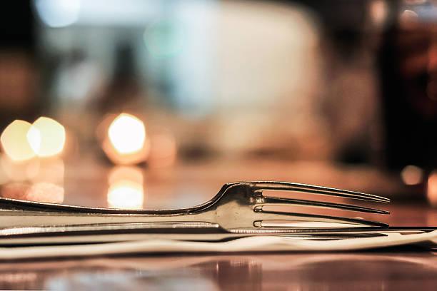 Sliver fork on table with blur lights behind – Foto