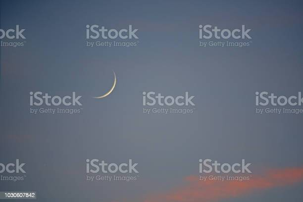 Photo of Sliver of a Crescent Moon at Sunset