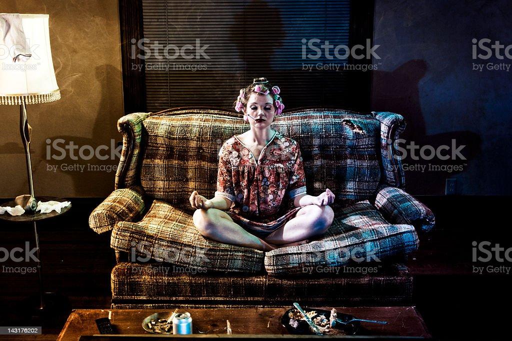 Slob Woman practicing Yoga while watching Telvision stock photo