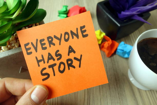 Slogan everyone has a story handwritten on sticky note stock photo