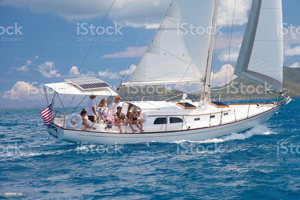 sloop sailing between US and British Virgin Islands stock photo
