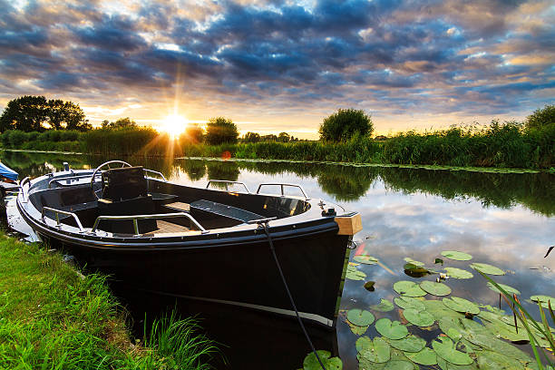 Sloop sunset stock photo