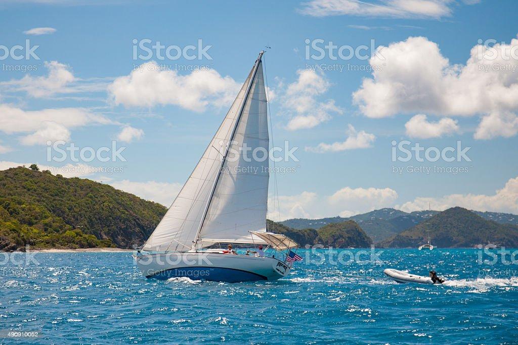 sloop under full sails traveling in the Virgin Islands stock photo