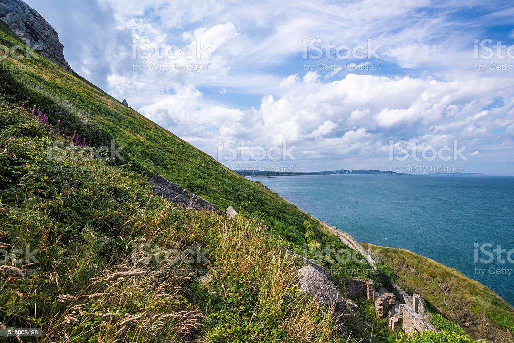Slope of the mountain at Irish seacoast. Bray, Greystone stock photo