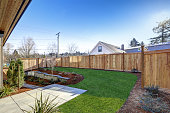 istock Sloped backyard of New construction home with open floor plan 640171608