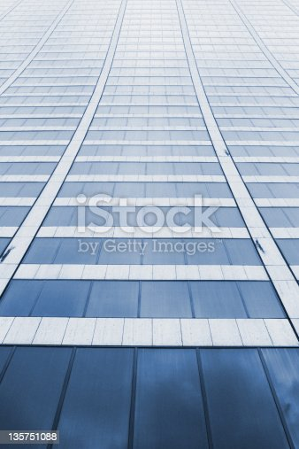 Low angle view of a curved office building.