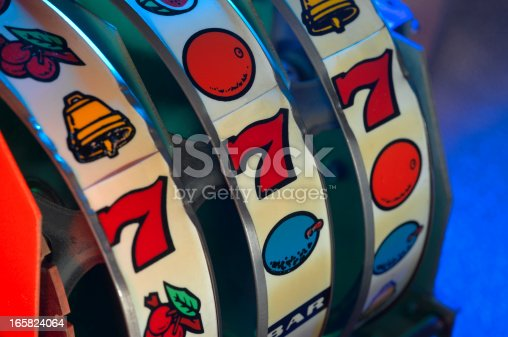A close-up view of an old slot machine winning numbers.