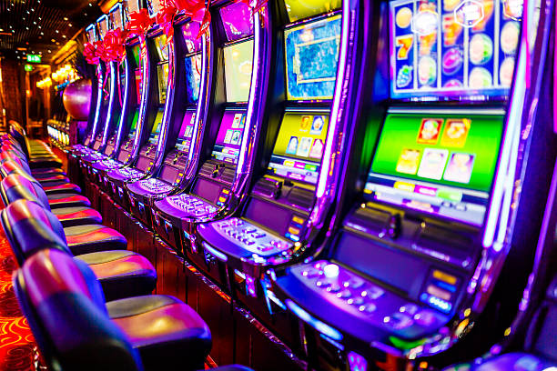 Slot machines in casino Line of electronic slot machines in casino. Property released. game of chance stock pictures, royalty-free photos & images