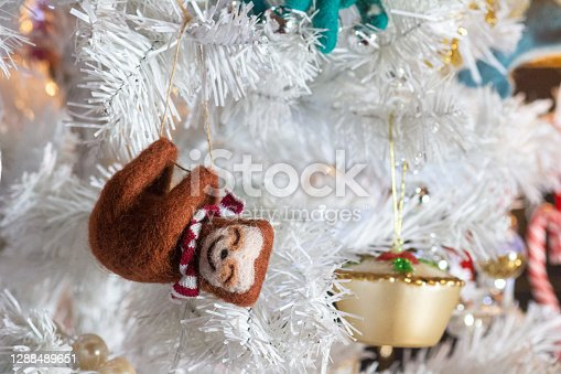 A Christmas tree decoration in the form of a sloth