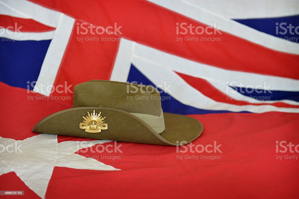 Slouch hat in front of a red Australian flag stock photo