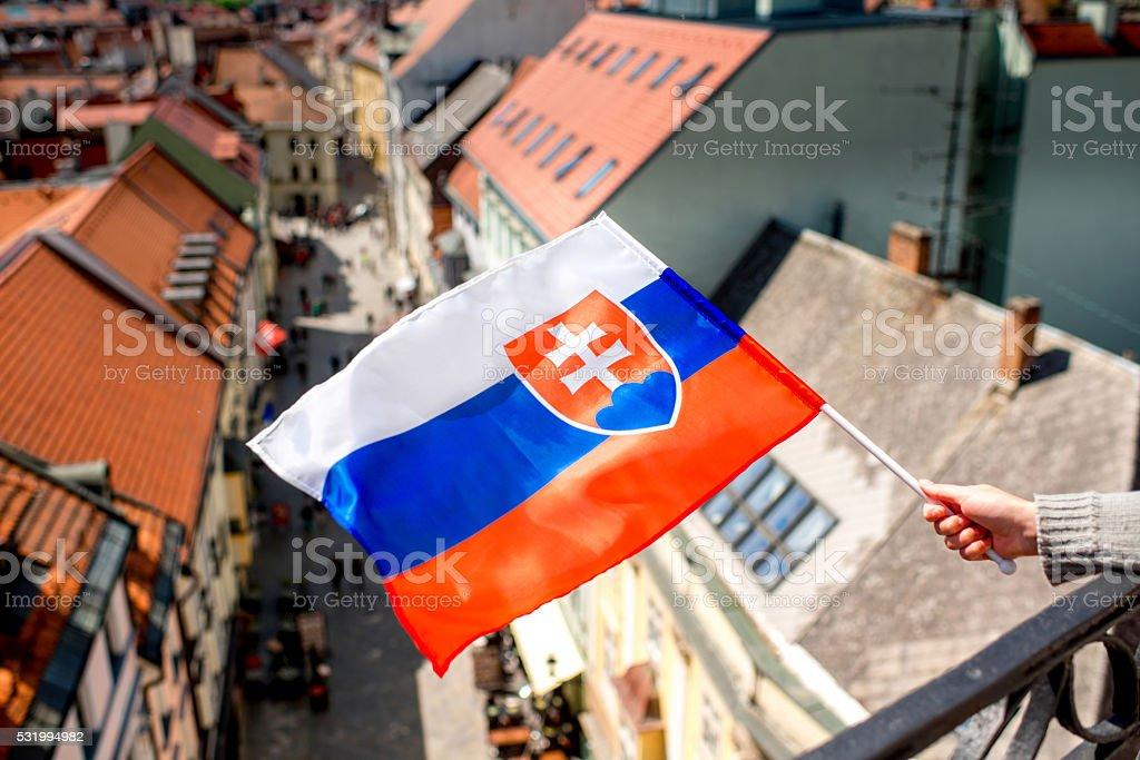 Slovak flag on Bratislava city background stock photo