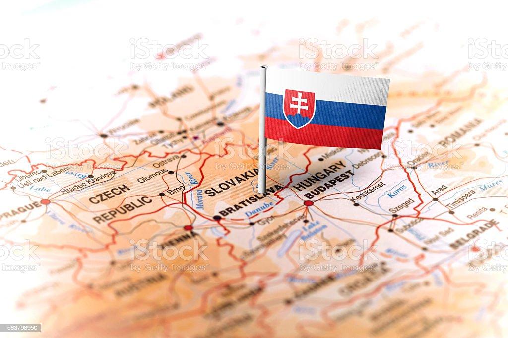 The flag of Slovakia pinned on the map. Horizontal orientation. Macro...