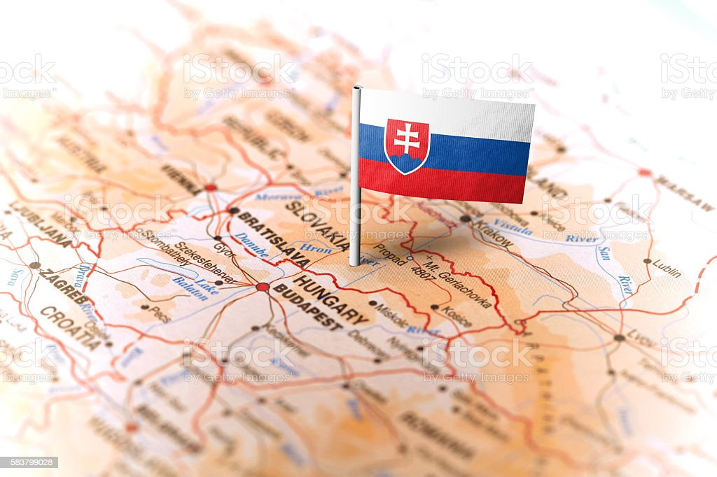 Slovakia pinned on the map with flag stock photo