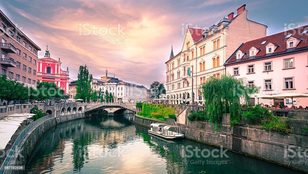 Slovenia Ljubljana Tromostovje Ljublianica river Church stock photo