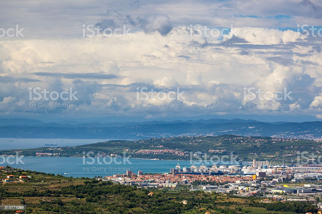 Slovenian coast town of Koper factories on Adriatic sea stock photo