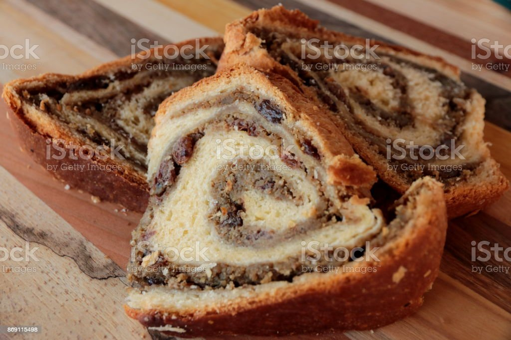 Slovenian traditional dessert-potica with walnuts and raisins stock photo