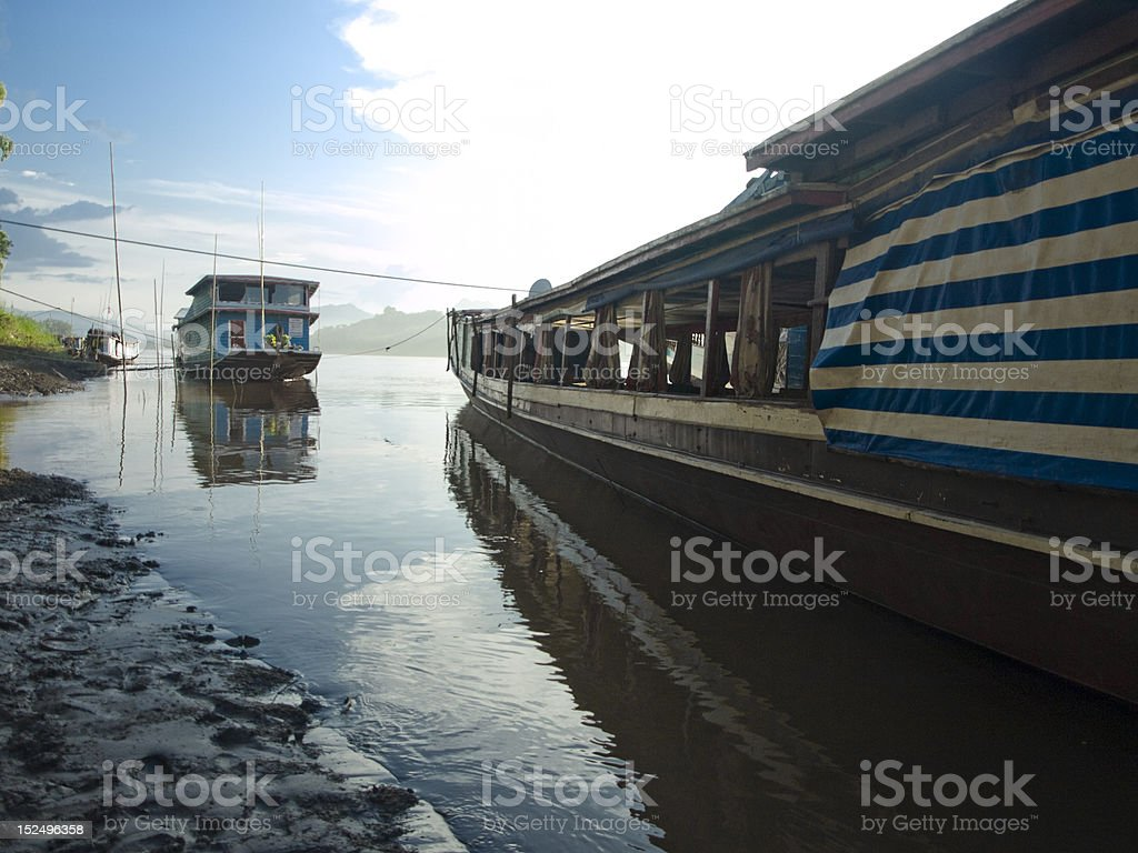 slow boats on the river stock photo
