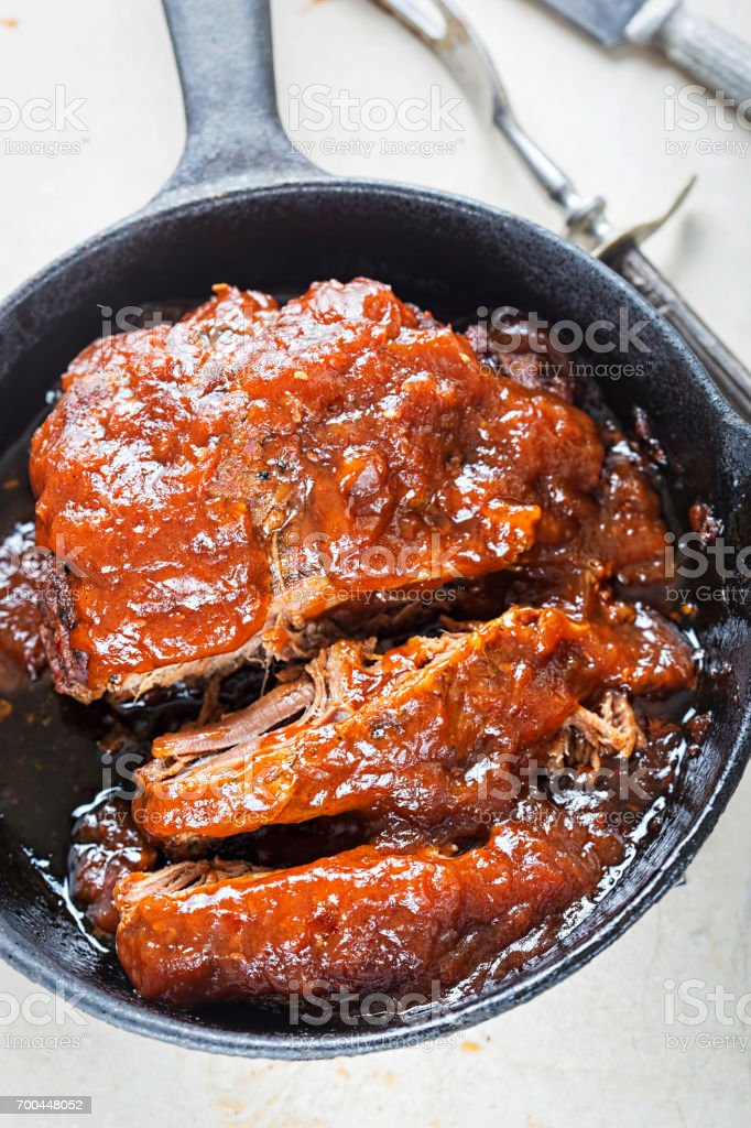 Slow cooked barbecue beef brisket with chipotle sauce stock photo