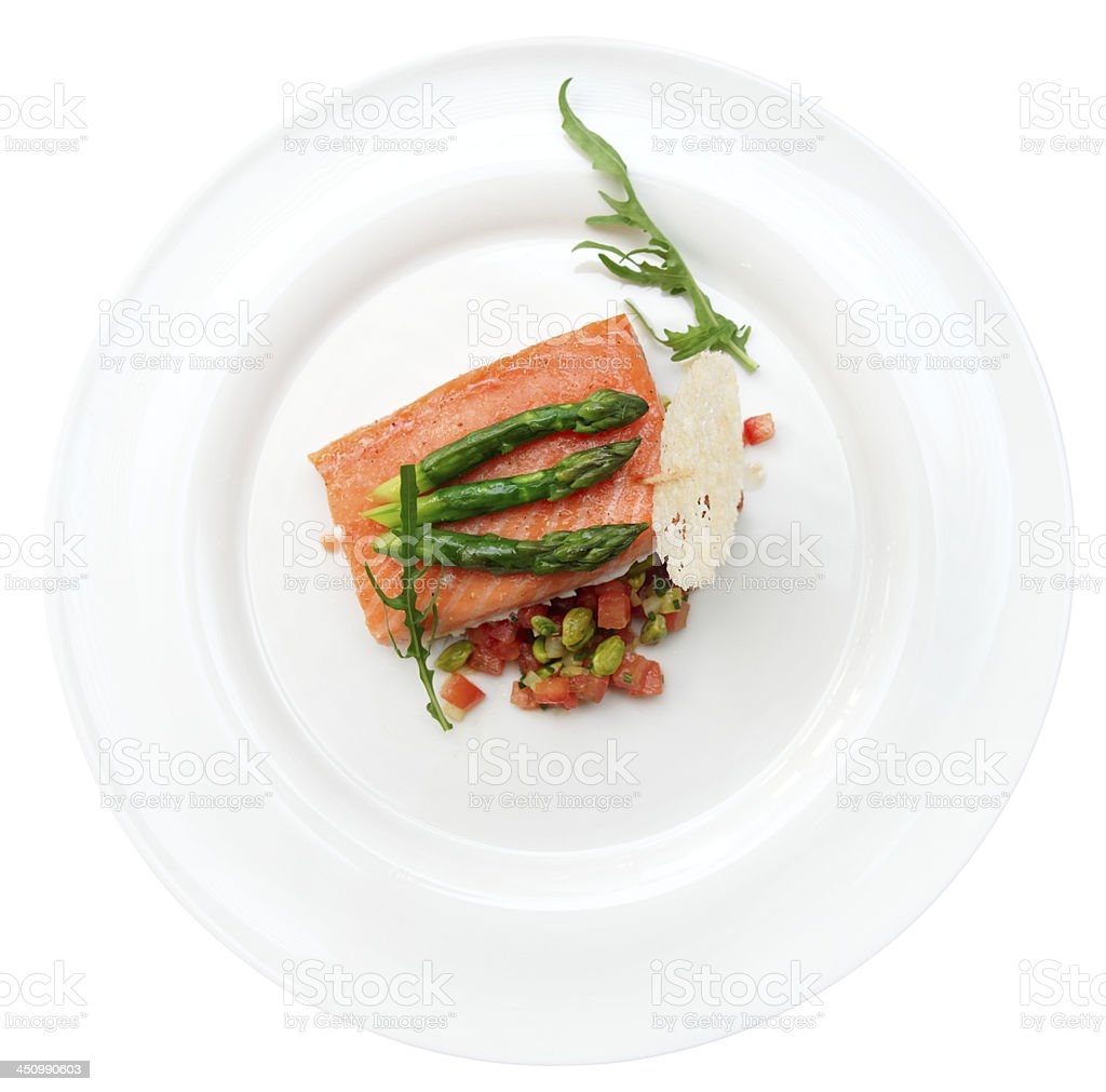 Slow cooked salmon steak in plate, isolated royalty-free stock photo