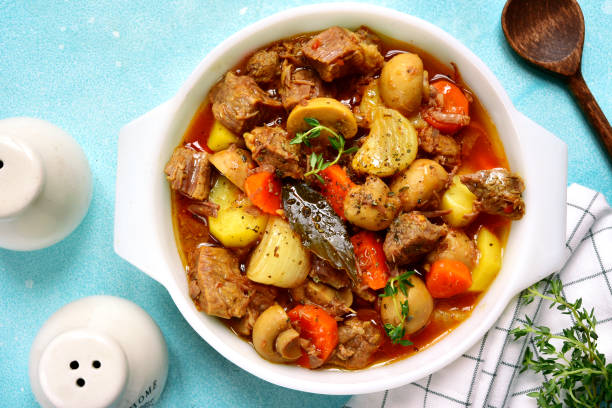 Slow cooker meat with vegetables in tomato sauce Slow cooker meat with vegetables in tomato sauce.Top view ragout stock pictures, royalty-free photos & images