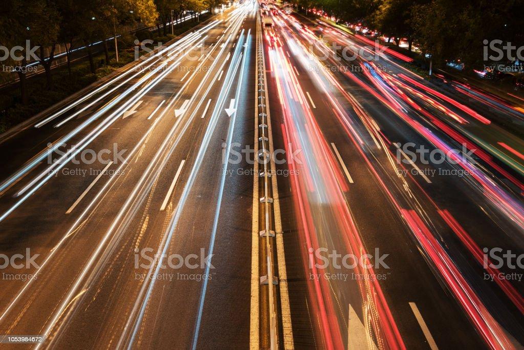 Slow door rails on night city road stock photo