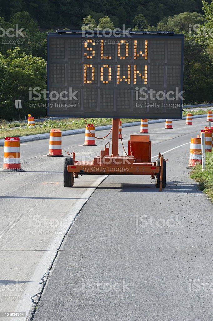 Slow Down Highway Warning Sign in Construction Zone royalty-free stock photo
