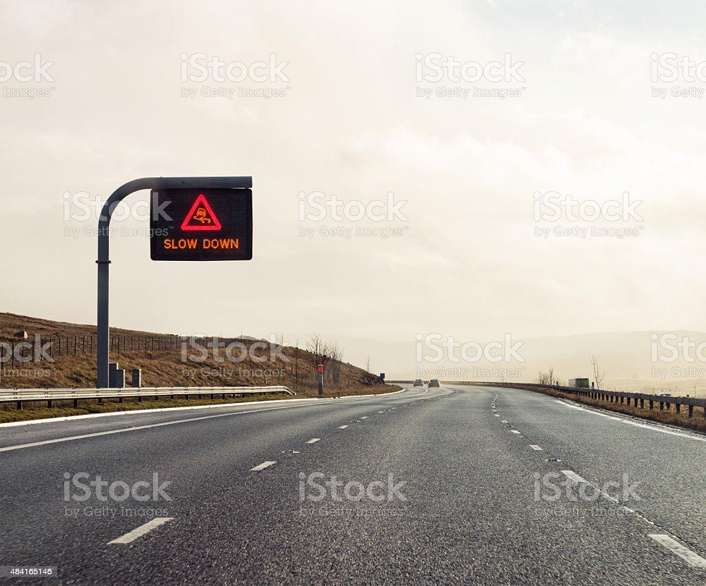 Slow Down UK Motorway warning sign stock photo