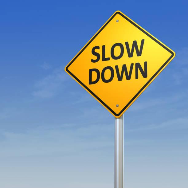 slow down warning sign - langzaam stockfoto's en -beelden