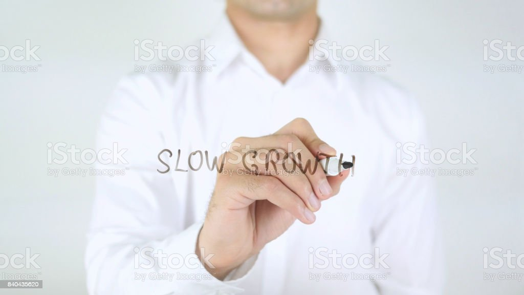 Slow Growth, Man Writing on Glass stock photo