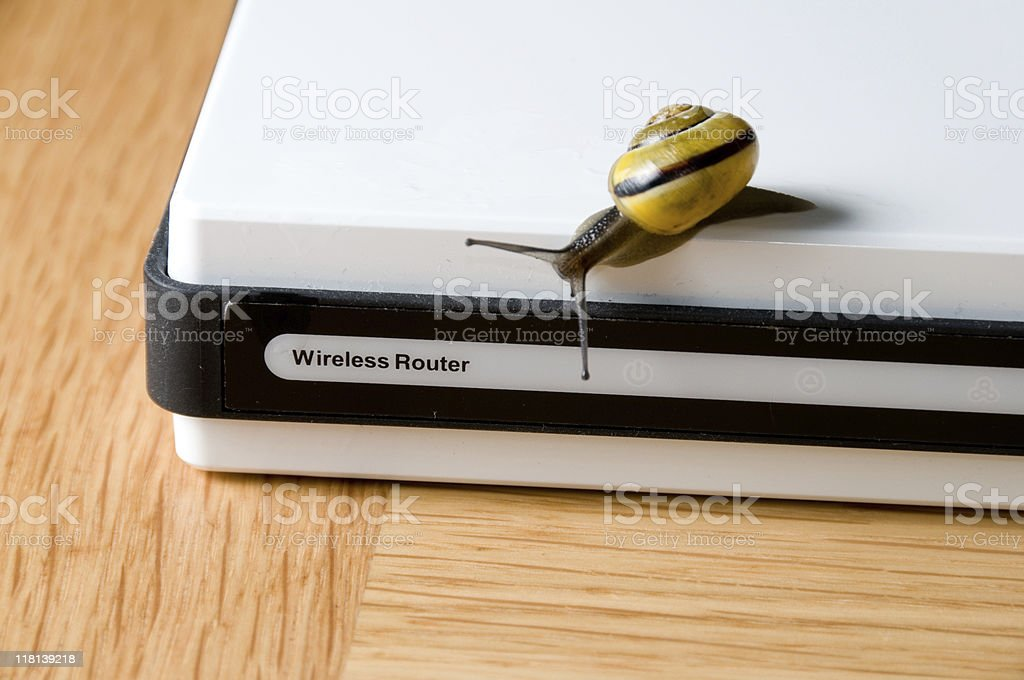 Slow internet connection symbolized with snail on wireless router stock photo