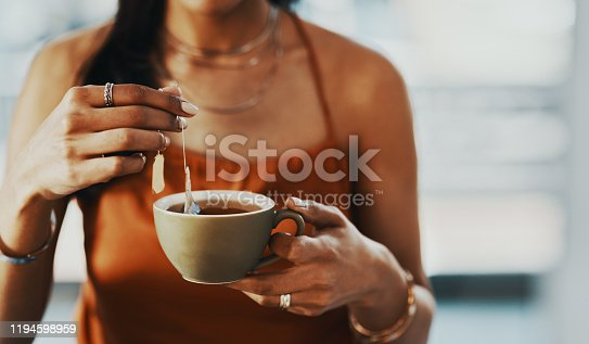Cropped shot of a woman having a tea break at home