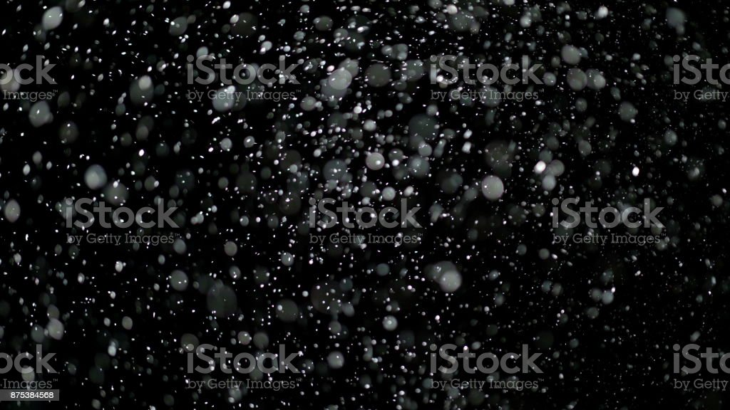 Slow Motion Snow on Black Background