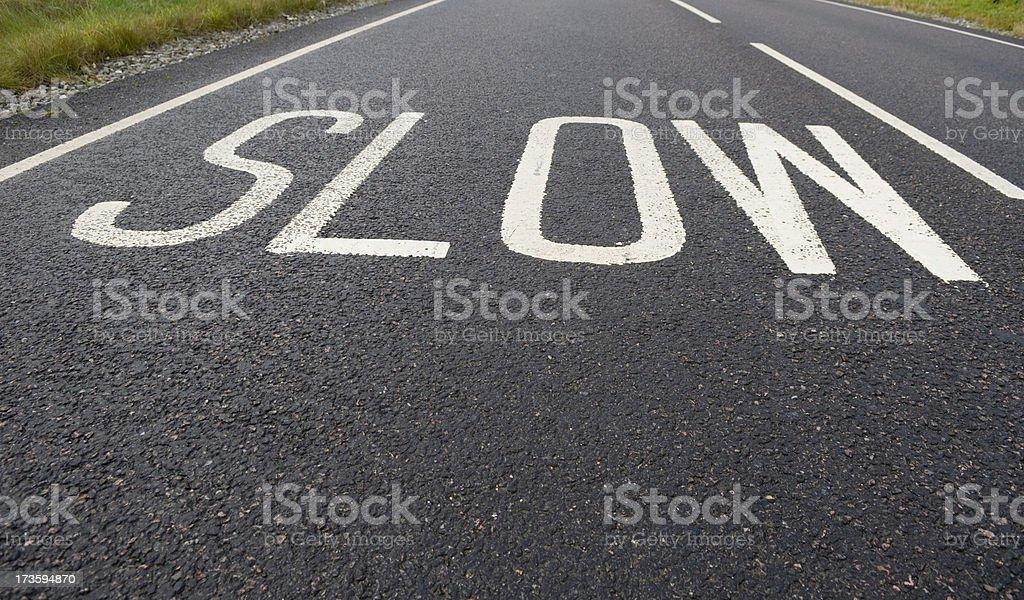 'Slow' road markings royalty-free stock photo