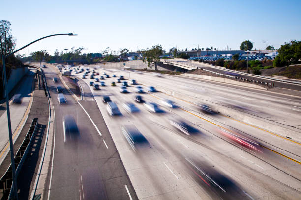 Slow shutter speed of cars moving on the 405 Freeway in Long Beach, California stock photo