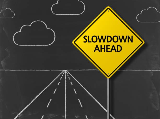 slowdown ahead - business chalkboard background - powolny zdjęcia i obrazy z banku zdjęć