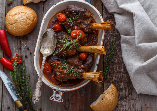 Slowly cooked lamb with tomato sauce and bread, turkish cuisine stock photo