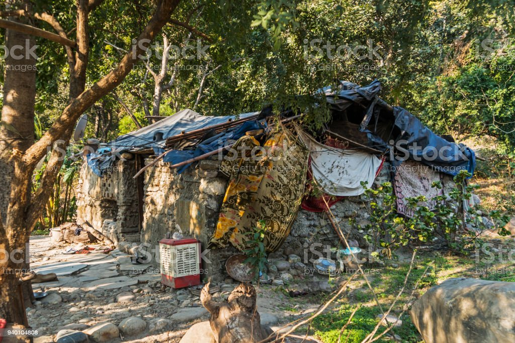 Slum house near the river, Goa, India stock photo