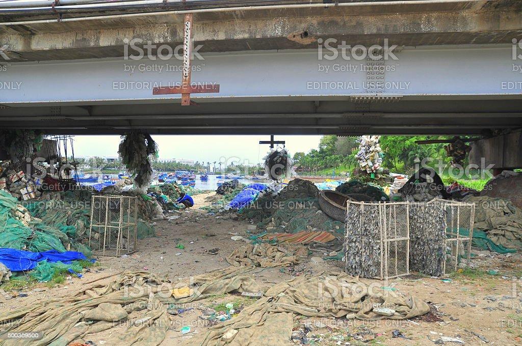 Slum under the bridge in Nha Trang city stock photo
