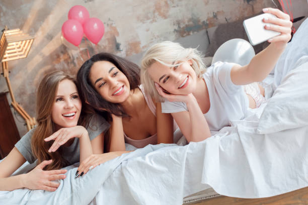 Slumber party young women together at home lying on bed taking selfie picture id1162853694?b=1&k=6&m=1162853694&s=612x612&w=0&h=wgm0e g3zghmsldrjcpnkszff2kozctcgjlv4yjivgw=