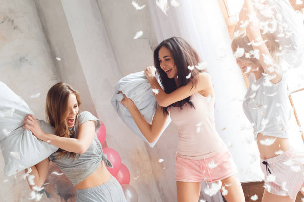 Slumber party young women together having fun on bed having pillow picture id1163243419?b=1&k=6&m=1163243419&s=612x612&w=0&h=9rsjxf apxnmtzicu8m3cbyju8jngbwaj2 ehojpr9k=