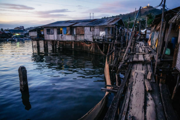 Slums with wooden houses near water, Coron city, Palawan, Philippines stock photo