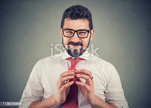 istock Sly businessman in glasses looking at camera plotting a revenge 1138293859