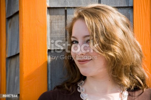 Sly Smiling Woman Stock Photo & More Pictures of 20-29 Years