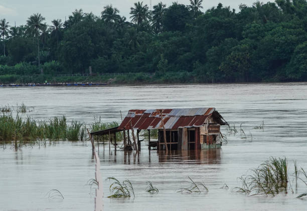 Small abandoned building in flooded Tonle Sap River, Cambodia. stock photo
